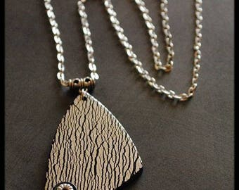 Polymer clay with crackled silver leaf pendant