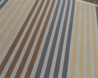 A lined fabric with blue, brown, and yellow stripes