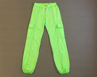 1990's, banded cuff, nylon pants, with cargo pockets, in lime green, Women's size Small