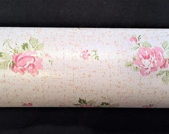 Roll of wall paper with tiny pink roses