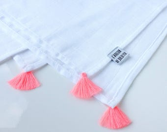 Muslin cloth with pink cotton tassels