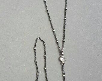 Oxidized sterling silver lariat with cubic zirconia and moonstone