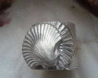 Silver Scallop Shell Ring is 31 grams of 99.9 fine silver - essentially pure silver - graced with a gleaming silver shell. Size 8 1/2.