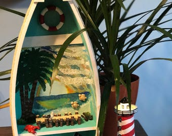 Shelf boat, hand painted beach mural with a battery operated lighthouse. Nautical.