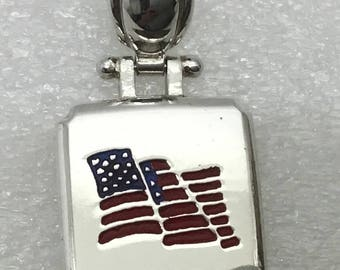 Wear the flag proudly! This vintage pendant is Sterling silver.