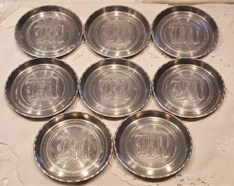Eight Vintage Aluminum Metal Coasters Embossed Letter M presented by Donellensvintage