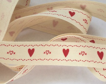decorative Ribbon: red heart on an ecru background
