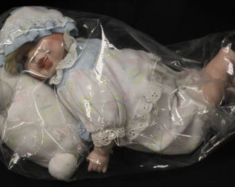 Vintage Porcelain Doll Laying on Pillow