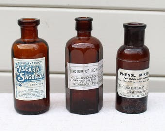 Three Victorian Brown Glass Apothecary Medicine Bottles