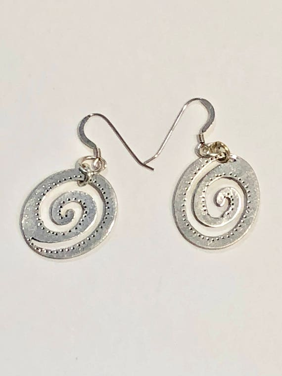 Handmade flattened silver color spiral earrings with silver plated ear wires