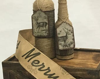Twine-wrapped bottle set with brown plaid and removable decorative deer tag. Two-Piece Holiday Bottle Set