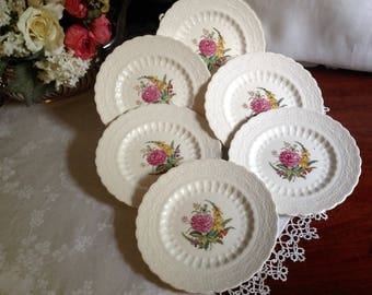 Spode jewel bread and butter or dessert plates in Heath and Rose pattern.  Think afternoon tea.