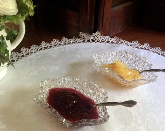 A pair of oval daisy and button EAPG  glass sauce dishes.  Use on your fancy tea table, for jelly, clotted cream, or lemon curd.