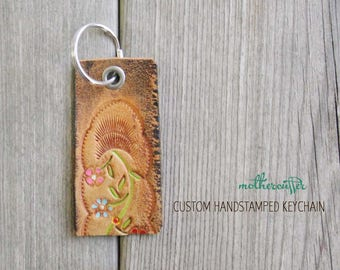 CUSTOM HANDSTAMPED brown leather keychain with painted flower design by mothercuffer