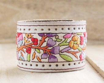 CUSTOM HANDSTAMPED white leather cuff with multi color stitching by mothercuffer