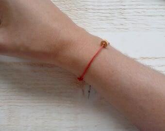 Pearl elder Bracelet on adjustable red cotton cord