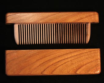 Wooden comb in a quince wood case