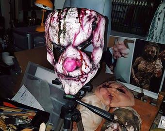 sown together clown mask with straps . horror .gore Halloween