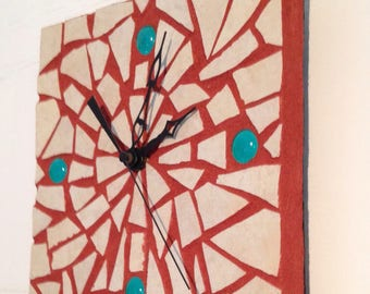 White Tiled Mosiac Clock on a Red Clay Background with Teal Beads and Black Clock Works Exclusive Design at Crafts by the Sea