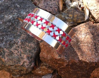 Red and gray embroidered cuff plated rose gold