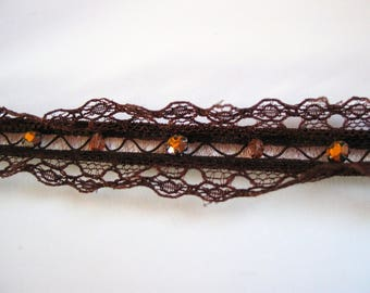 Brown elastic lace embellished with pearls and rhinestones