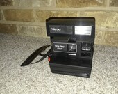 Vintage Polaroid One Step Flash instant camera for parts, repair or restoration