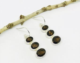 Smokey topaz earrings set in sterling sliver 92.5. Natural smokey topaz stones. Length-1 inch long. Perfectly mtached stones