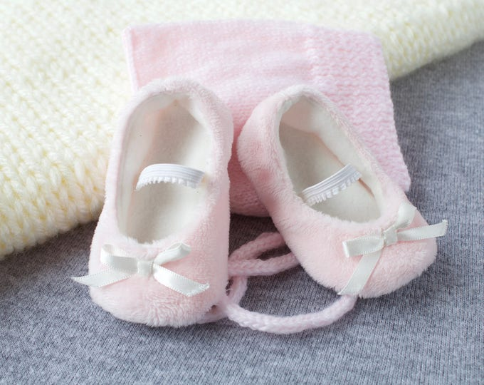 Fluffy baby girl shoes with a cute little ivory satin bow