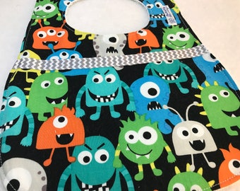 Baby/ Toddler bib with monsters and a chevron trim