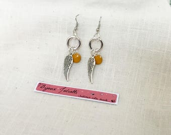 wings earrings and a mustard yellow sequin