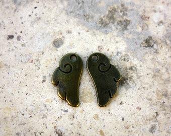 5 pendants stylized wings brass 17 x 9 mm