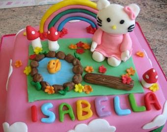 Edible Hello Kitty cake topper set.