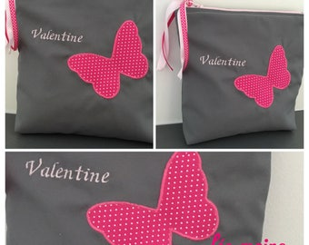 Pink toiletry bag in grey cotton with a butterfly with the name embroidered
