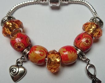 Orange charms bracelet with charms and beads ref 234