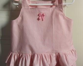 Pink baby bib in cotton gingham dress