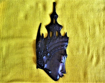 Buddha's head, sculpture on ebony of Macassar in bas-relief, headdress decorated with pagoda, Indonesia, Bali, 1970s