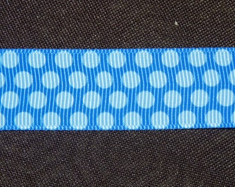 Ribbon blue grosgrain with polka dots.