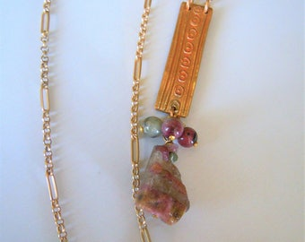 Golden bronze pendant with tourmaline necklace.