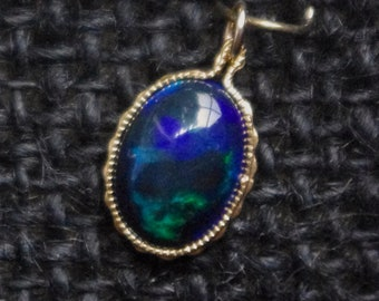 Solid Welo Opal on 14kt gold fill setting