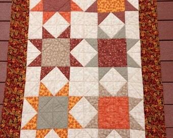 Handmade quilted lap quilt - Ohio Star blocks