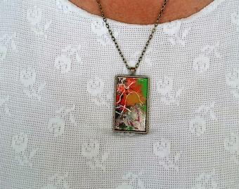 "bronze pendant ""shedding"" on metal chain"