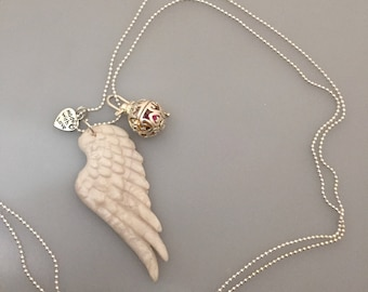 Angel Wing necklace, call Pocketful of sonaglietti within the pendant to gabietta, handmade fimo, Angel Wing caller, Angel