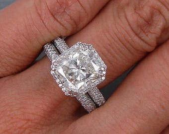 Beautiful 4.14 ctw Radiant Cut Diamond Engagement Ring and Wedding Band with a 3.00 Radiant Cut G Color/SI1 Clarity Enhanced Center Diamond