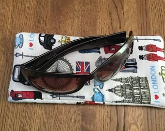 Sunglass sleeve in London Look fabric with a red spot lining. A slip and tip style sleeve which is perfect to pop in your bag