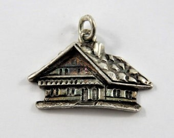 3 D Style Lodge or Cottage .800 Silver Charm or Pendant.Marked .800 on the Ring of the Charm.