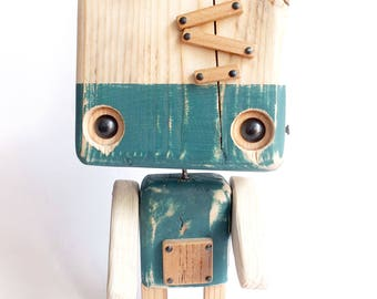 Blue robot made of recycled wood - factory