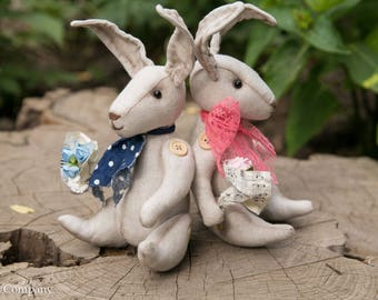 Stuffed bunny toys with blue and pink bows. Fabric beige bunnies. Alice in Wonderland rabbits. Bunny lover gift.