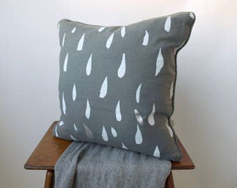 Grey linen cushion cover with silver and white teardrop design screenprinted by hand