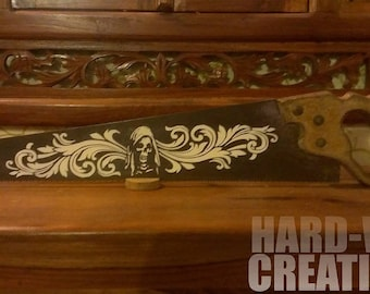 Old handsaw customized with a baroque pattern