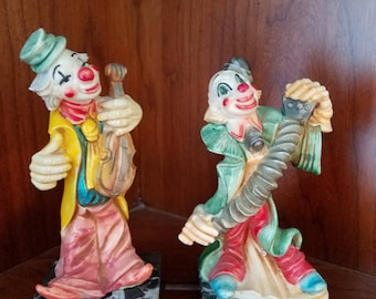 Clowns playing Accordion and Violin Statues, Italy